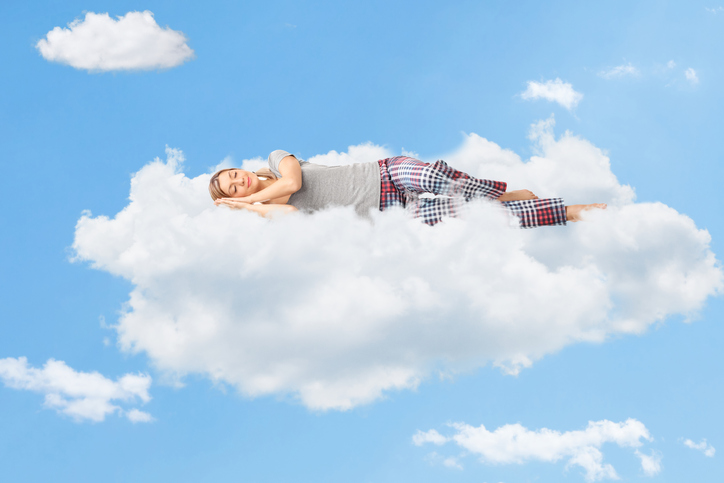 Woman sleeping on a cloud, Sedation Dentistry Portland, OR